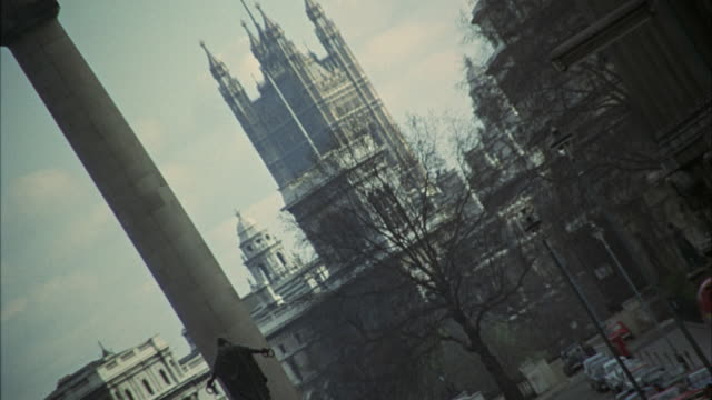 1966 zo ws canted duke of york statue and victoria tower, busy street in foreground / london, united kingdom - 1966 stock videos and b-roll footage