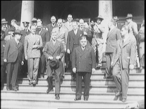 Duke on steps of New York City Hall waves / Duke of Windsor with Mayor Fiorello La Guardia large crowd watches / cameraman lying on ground filming /...