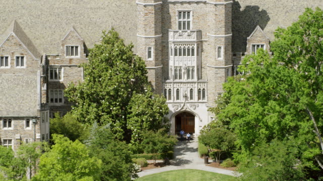 MS AERIAL POV Duke University surrounded by tree/ Durham, North Carolina, United States