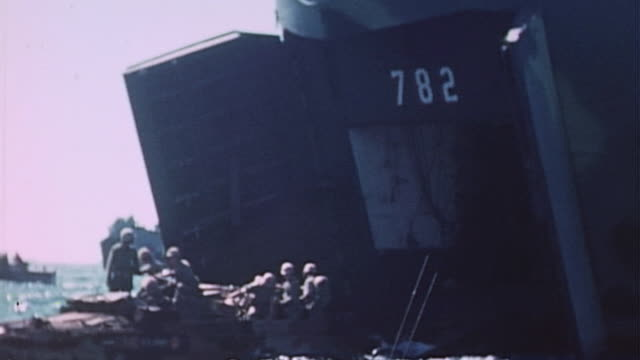 dukws driving down ramp and into water from lst782 during world war ii pacific island invasion - heckklappe teil eines fahrzeugs stock-videos und b-roll-filmmaterial