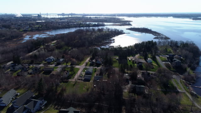duluth city at the lake superior, at the border of minnesota and wisconsin. aerial video with the cinematic complex panoramic and orbit camera motion. - great lakes stock videos & royalty-free footage
