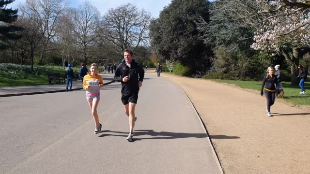 dulwich park is busy with members of the public walking their dogs jogging riding bikes and walking with their children during the coronavirus... - brian dayle coronavirus stock videos & royalty-free footage
