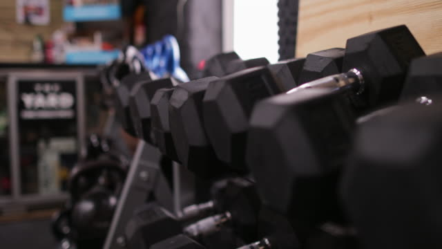 dumbbells at fitness gym - dumbbell stock videos & royalty-free footage