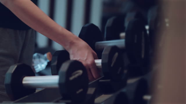 dumbbells sports and fitness weight training equipment - rack stock videos & royalty-free footage
