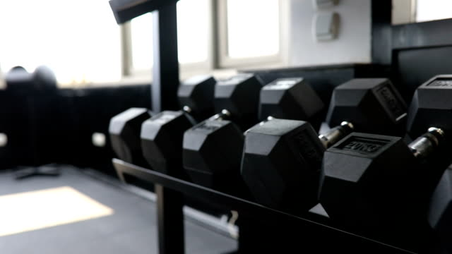 dumbbells - exercise machine stock videos & royalty-free footage