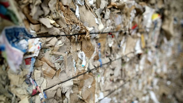 dump of old stacked paper,close up.recycling center collects cartoon boxes - bale stock videos & royalty-free footage