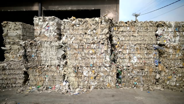 dump of old stacked paper.recycling center collects cartoon boxes - bale stock videos & royalty-free footage