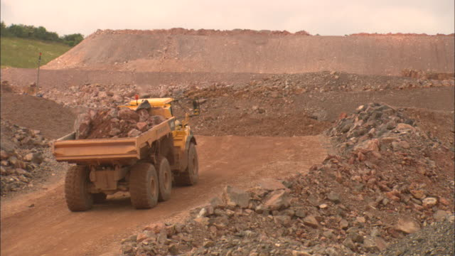 a dump truck carries rubble out of a quarry. - rubble stock videos & royalty-free footage