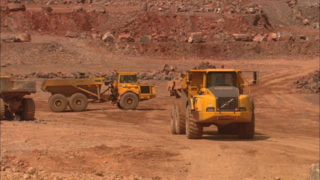 a dump truck carries rubble through a quarry. - rubble stock-videos und b-roll-filmmaterial