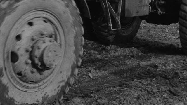 1954 montage dump truck climbing hill on obstacle course during performance trials / arkwright, england, united kingdom - 1954 stock videos & royalty-free footage