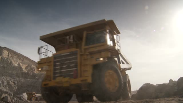 a dump truck drives through a quarry in africa. available in hd. - dump truck stock videos and b-roll footage