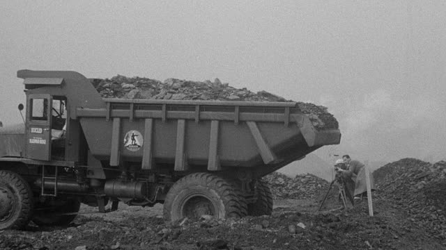 1954 b/w dump truck dumping dirt during performance trials / arkwright, england, united kingdom - 1954 stock videos & royalty-free footage
