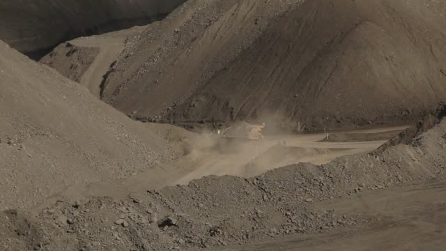 dump truck makes dust - pit mine stock videos and b-roll footage