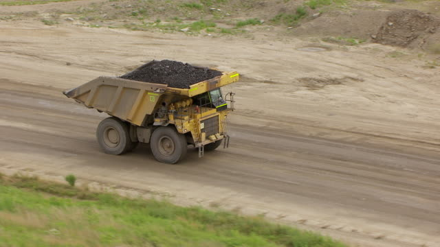 WS TS AERIAL POV Dump truck moving on road near surface mine area / Gibson County, Somerville, Indiana, United States
