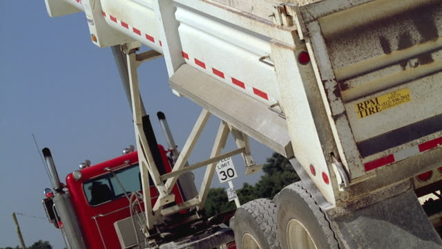 ms pan dump truck pouring dirt and gravel / georgetown, texas, usa - dump truck stock videos and b-roll footage