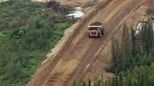 a dump truck travels past the tar sands at fort mackay, alberta, canada. - alberta stock videos & royalty-free footage