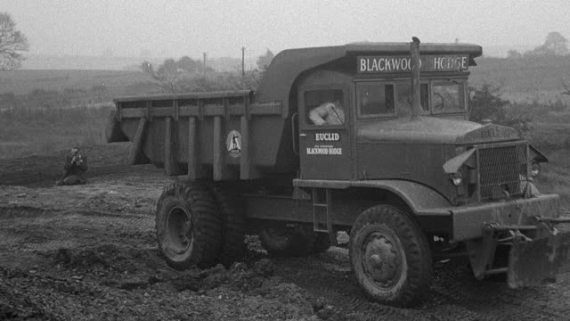 1954 montage dump truck traversing obstacle course during performance trials / arkwright, england, united kingdom - 1954 stock videos & royalty-free footage