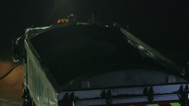 ms td dump truck unloading asphalt / london, england, united kingdom - asphalt stock-videos und b-roll-filmmaterial