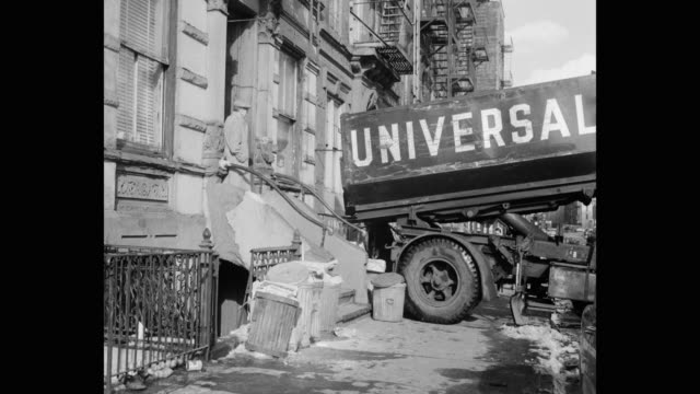 dump truck unloading coal into residential building on madison st, lower east side, new york city, new york state, usa - western script stock videos & royalty-free footage