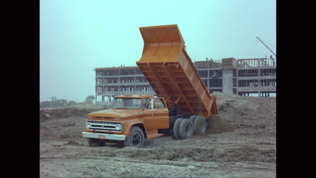 ws dump truck unloading soil at construction site / united states - chevrolet stock videos & royalty-free footage