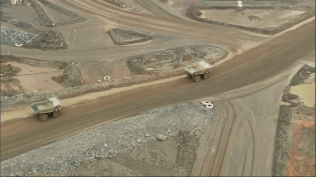 dump trucks haul material at the super pit gold mine in western australia. available in hd. - pit mine stock videos and b-roll footage
