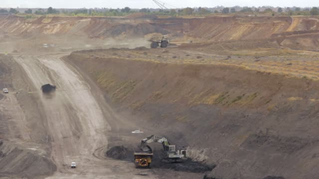 dump trucks loaded with coal - timelapse - pit mine stock videos and b-roll footage