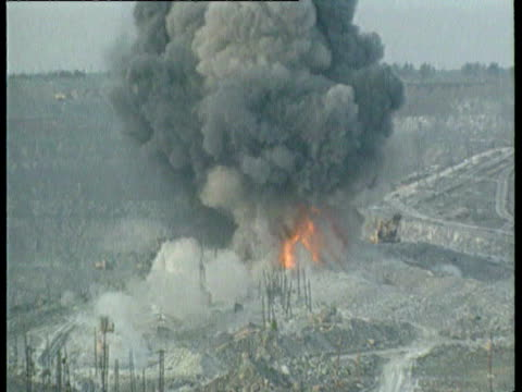 dump trucks steam shovels and blasting at asbestos quarry asbestos quarry on november 17 1992 in asbest russia - asbest stock-videos und b-roll-filmmaterial