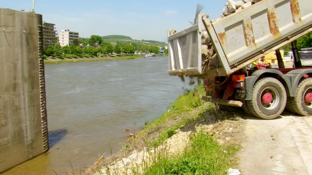 MS dumper loading off material at deconstruction of bridge over river Mosel / Wellen, Rhineland Palatinate, Germany
