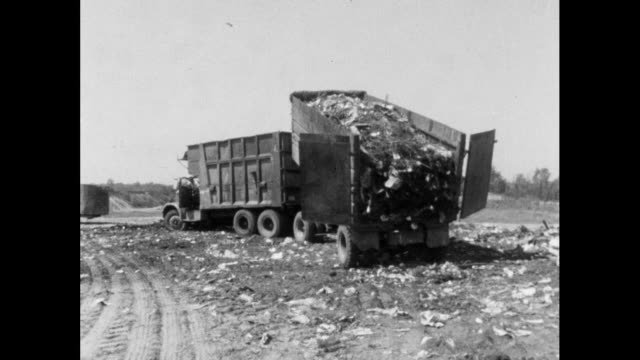 vidéos et rushes de ws dumper truck emptying rubbish from trailer; 1964 - décharger