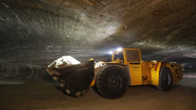 a dumper truck removes rock from the underground potash mine at the usolskiy potash complex operated by eurochem group ag at the verkhnekamskoe... - dumper truck stock videos & royalty-free footage