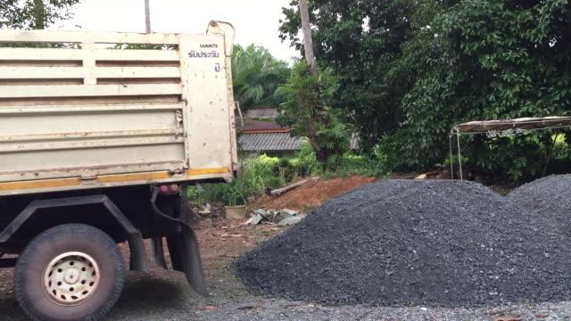 dumper truck unloading soil - dumper truck stock videos & royalty-free footage