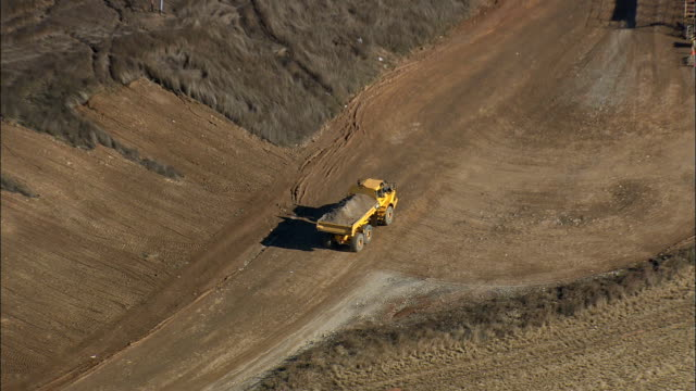 dumper truck with dirt - aerial view - south carolina,  spartanburg county,  united states - dump truck stock videos and b-roll footage