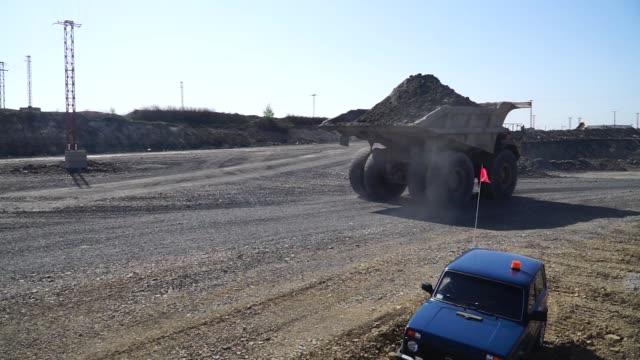 Dumper trucks are loaded with excavated iron ore rock at the Yeristovo and Poltava iron ore mine operated by Ferrexpo Poltava Mining PJSC in Poltava...