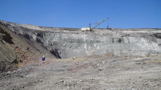 dumper trucks are loaded with excavated iron ore rock at the yeristovo and poltava iron ore mine operated by ferrexpo poltava mining pjsc in poltava... - iron ore stock videos & royalty-free footage