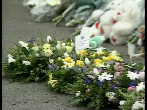 dunblane massacre aftermath:; scotland: dunblane: ext blair lays floral wreath as major and norma look on and then michael forsyth lays wreath cms... - dunblane stock videos & royalty-free footage