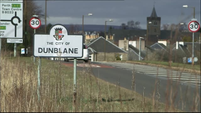 20th anniversary work of the dunblane centre 'city of dunblane' sign at roadside high angle shot of dunblane primary school - dunblane school massacre stock videos & royalty-free footage