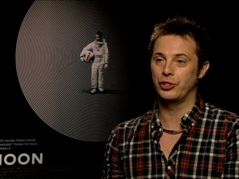 duncan jones on how many films from the seventies influenced the movie at the moon interview at london england. - persuasion stock videos & royalty-free footage