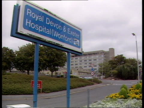 vídeos de stock, filmes e b-roll de cancer patient radiation overdose exeter ms 'royal devon exeter hospital' sign and hospital beyond ms xray machine - overdose