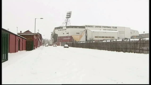 exterior of dundee united fc football stadium, tannadice park, covered in snow - dundee scotland stock videos & royalty-free footage