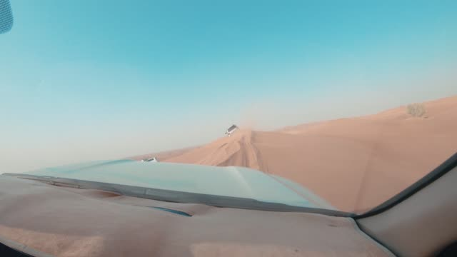 dune bashing in the desert - hitting stock videos and b-roll footage