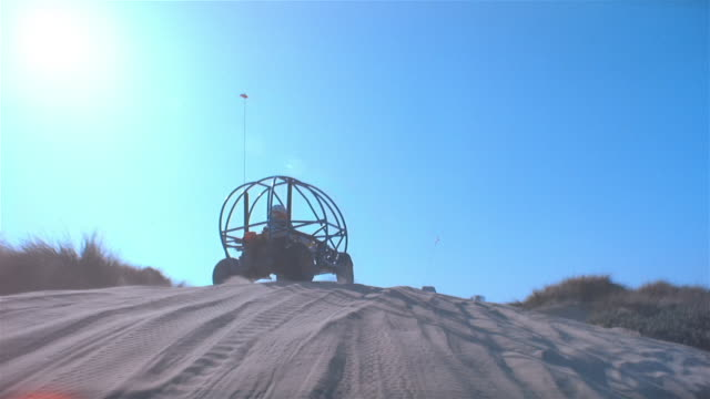 pov, dune buggy driving fast through sand dunes, california, usa - dune buggy stock videos and b-roll footage