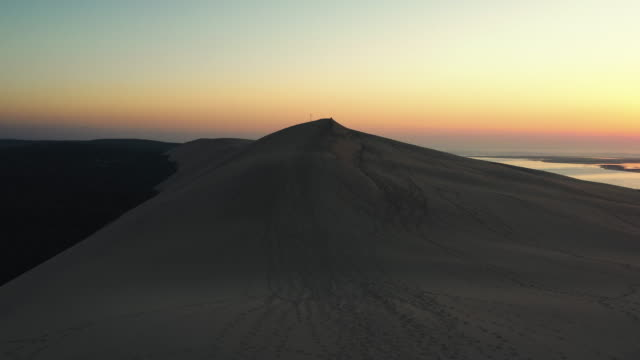 dune of pilat at sunset filmed by drone, france - atmospheric mood stock videos & royalty-free footage