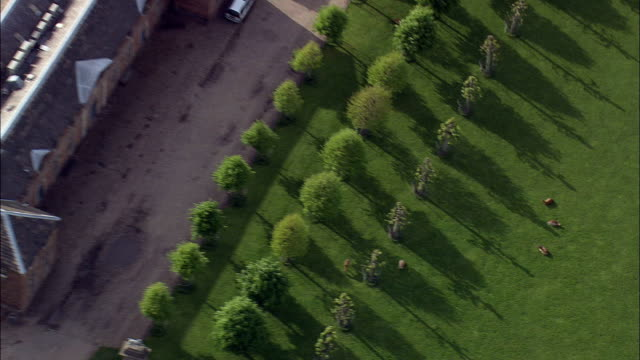 dunham massey hall - aerial view - england,  liverpool,  helicopter filming,  aerial video,  cineflex,  establishing shot,  united kingdom - merseyside stock videos and b-roll footage