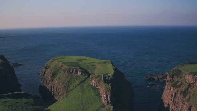 dunseverick castle ruins, antrim coast, northern ireland. aerial drone view - protection stock videos & royalty-free footage