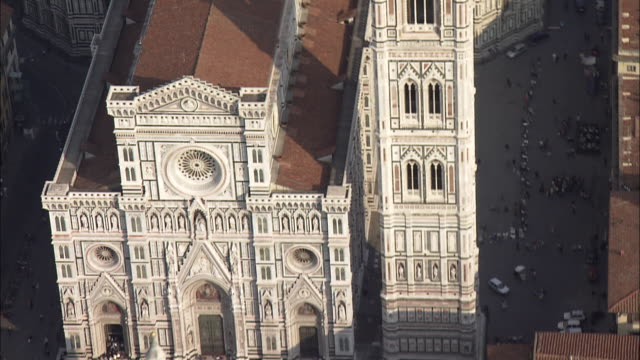 duomo and its spectacular bell tower rises above florence, italy. - classical style stock videos & royalty-free footage