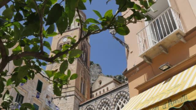 duomo di amalfi and statue on duomo piazza, amalfi, costiera amalfitana (amalfi coast), unesco world heritage site, campania, italy, europe - cathedral stock videos and b-roll footage