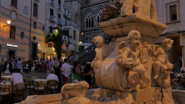 duomo di amalfi and statue on duomo piazza at dusk, amalfi, costiera amalfitana (amalfi coast), unesco world heritage site, campania, italy, europe - amalfi stock videos and b-roll footage
