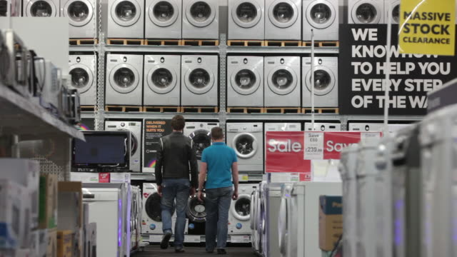 durable goods on display at curry's department store - haltbarkeit stock-videos und b-roll-filmmaterial