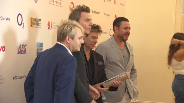 stockvideo's en b-roll-footage met duran duran at silver clef awards on july 03 2015 in london england - duran duran