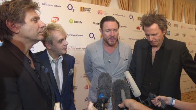 duran duran on new album, working with different music artist, changing thier style, lindsay lohan on their new album at silver clef awards on july... - duran duran stock videos & royalty-free footage